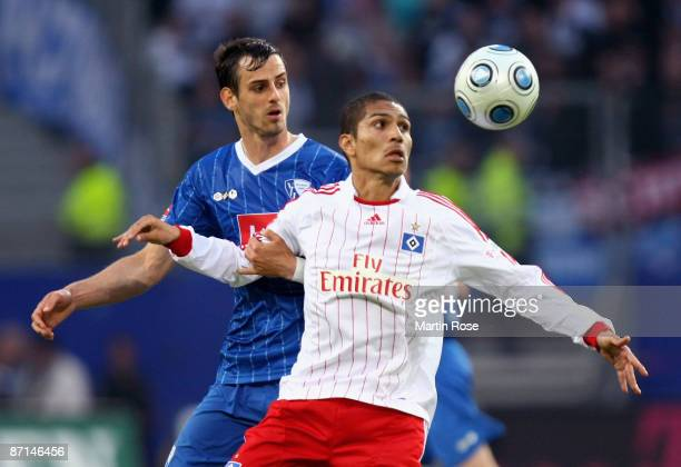 Paolo Guerrero of Hamburg and Matias Concha of Bochum battle for the ball during the Bundesliga match between Hamburger SV and VfL Bochum at the HSH...