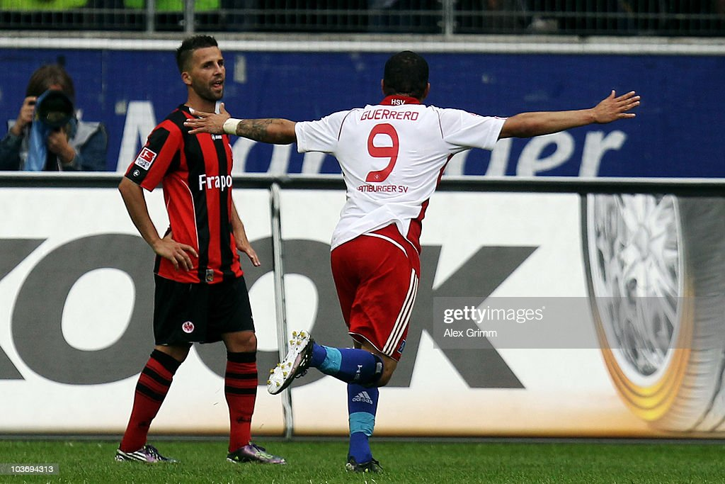 Paolo Guerrero (R) of Hamburg celebrates his team's third goal as <a gi-track='captionPersonalityLinkClicked' href=/galleries/search?phrase=Benjamin+Koehler&family=editorial&specificpeople=635185 ng-click='$event.stopPropagation()'>Benjamin Koehler</a> of Frankfurt reacts during the Bundesliga match between Eintracht Frankfurt and Hamburger SV at the Commerzbank Arena on August 28, 2010 in Frankfurt am Main, Germany.