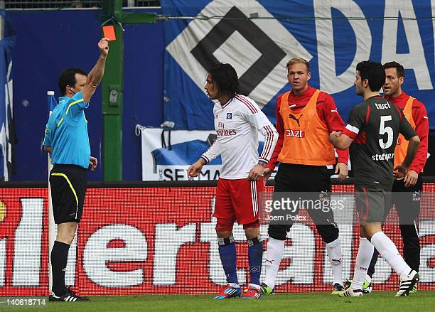 Paolo Guerrero of Hamburg gets the red card from referee Peter Sippel during the Bundesliga match between Hamburger SV and VfB Stuttgart at Imtech...