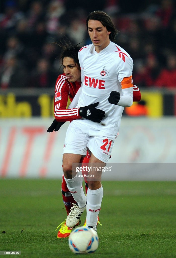 Paolo Guerrero of Hamburg is blocked by <a gi-track='captionPersonalityLinkClicked' href=/galleries/search?phrase=Pedro+Geromel&family=editorial&specificpeople=5295583 ng-click='$event.stopPropagation()'>Pedro Geromel</a> of Koeln during the Bundesliga match between 1. FC Koeln and Hamburger SV at RheinEnergieStadion on February 12, 2012 in Cologne, Germany.