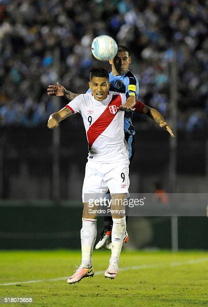 Paolo Guerrero of Peru and Maximiliano Pereira of Uruguay fight for the ball during a match between Uruguay and Peru as part of FIFA 2018 World Cup...