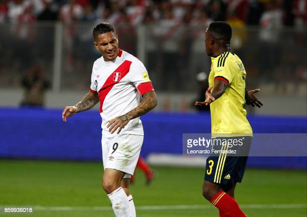 Paolo Guerrero of Peru argues with Davinson Sanchez of Colombia during match between Peru and Colombia as part of FIFA 2018 World Cup Qualifiers at...