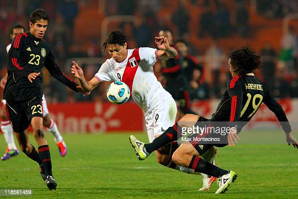 Paolo Guerrero of Peru battles for the ball against Héctor Reynoso of Mexico during a match as part of group C of 2011 Copa America at Malvinas...