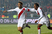 Paolo Guerrero of Peru celebrates with teammate Andre Carrillo after scoring the second goal of his team during the 2015 Copa America Chile Third...