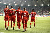 Paolo Guerrero of Peru celebrates with teammates after scoring the opening goal during the 2015 Copa America Chile quarter final match between Peru...
