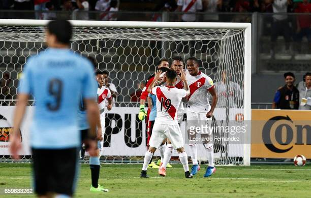 Paolo Guerrero of Peru celebrates with teammates after scoring the first goal of his team during a match between Peru and Uruguay as part of FIFA...