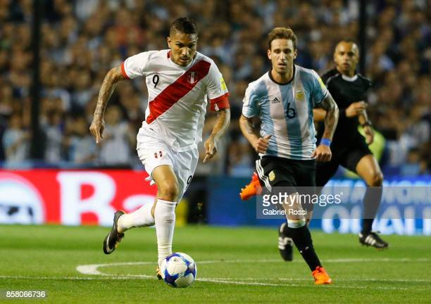 Paolo Guerrero of Peru drives the ball followed by Lucas Biglia of Argentina during a match between Argentina and Peru as part of FIFA 2018 World Cup...
