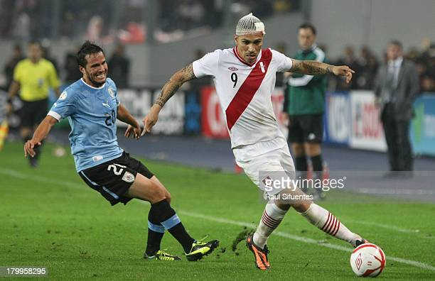 Paolo Guerrero of Peru fights for the ball with Alvaro Gonzales of Uruguay during a match between Peru and Uruguay as part of the 15th round of the...