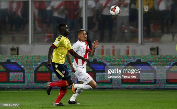 Paolo Guerrero of Peru fights for the ball with Davinson Sanchez of Colombia during match between Peru and Colombia as part of FIFA 2018 World Cup...