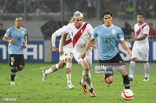Paolo Guerrero of Peru fights for the ball with Edison Cavani of Uruguay during a match between Peru and Uruguay as part of the 15th round of the...