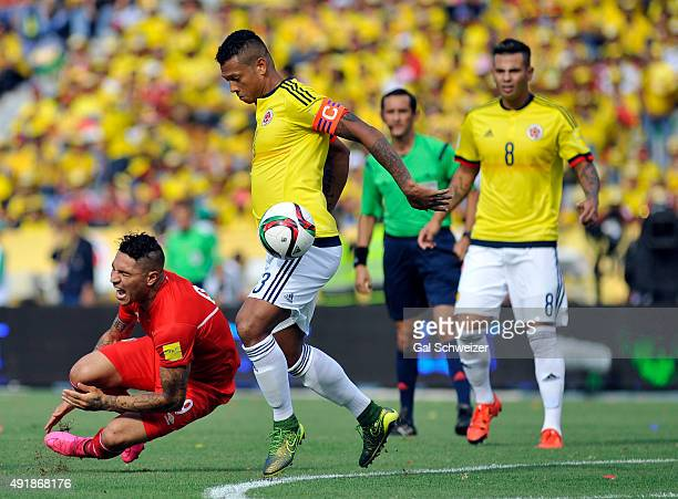 Paolo Guerrero of Peru fights for the ball with Fredy Guarin of Colombia during a match between Colombia and Peru as part of FIFA 2018 World Cup...