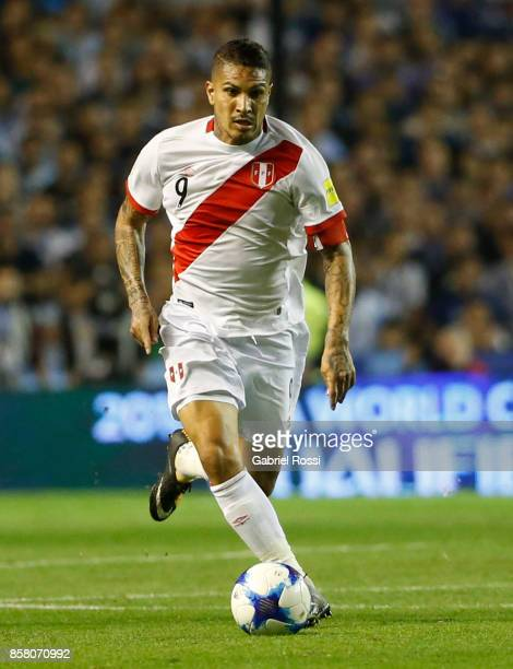 Paolo Guerrero of Peru fights for the ball with Lucas Biglia of Argentina during a match between Argentina and Peru as part of FIFA 2018 World Cup...