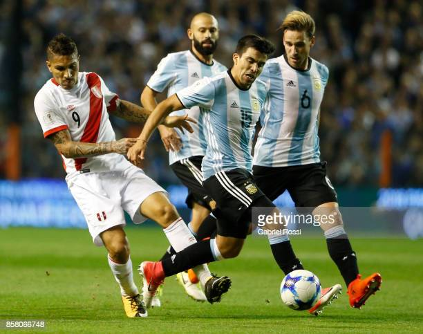Paolo Guerrero of Peru fights for the ball with Marcos Acuña of Argentina during a match between Argentina and Peru as part of FIFA 2018 World Cup...