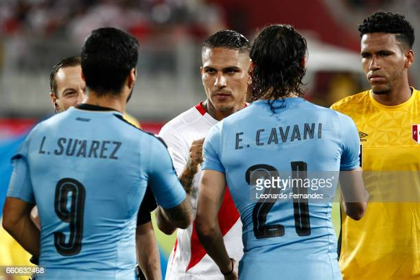 Paolo Guerrero of Peru looks greets Luis Suarez of Uruguay prior to a match between Peru and Uruguay as part of FIFA 2018 World Cup at Nacional...