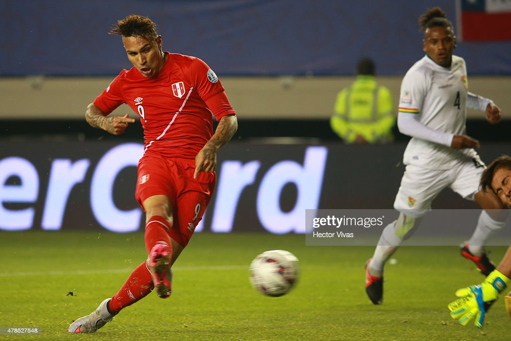 Paolo Guerrero of Peru shoots to score the second goal of his team during the 2015 Copa America Chile quarter final match between Peru and Bolivia at German Becker Stadium on June 25, 2015 in Temuco, Chile.