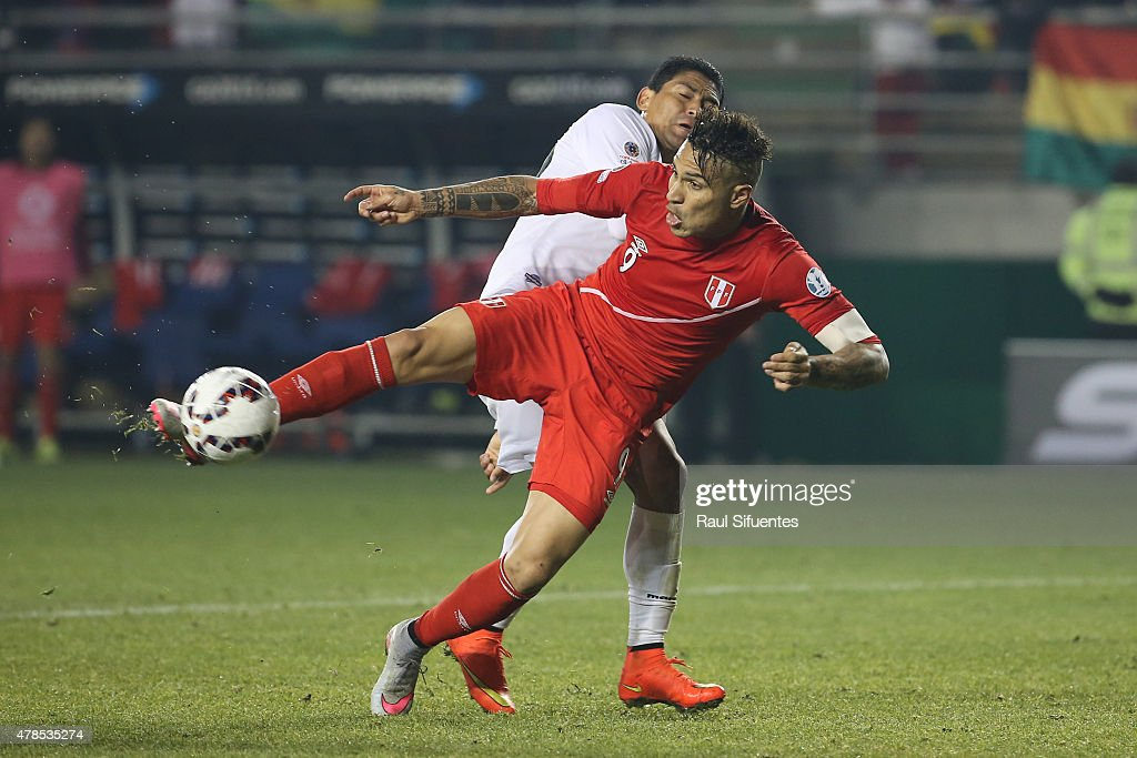 Paolo Guerrero of Peru shoots to score the third goal of his team during the 2015 Copa America Chile quarter final match between Peru and Bolivia at German Becker Stadium on June 25, 2015 in Temuco, Chile.