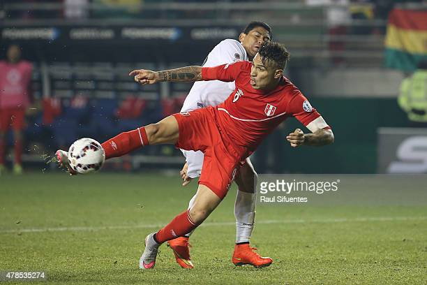 Paolo Guerrero of Peru shoots to score the third goal of his team during the 2015 Copa America Chile quarter final match between Peru and Bolivia at...