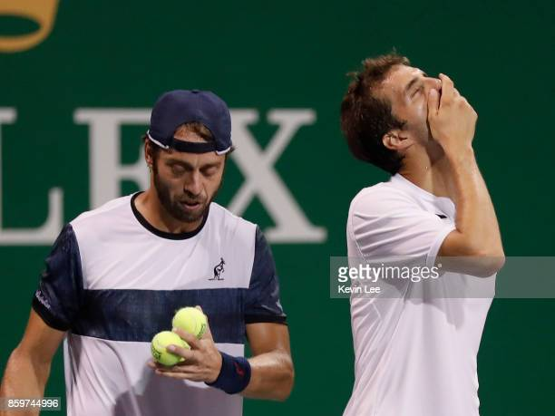 Paolo Lorenzi of Italy and Albert RamosVinolas of Spain in action against Santiago Gonzalez of Mexico and Julio Peralta of Chile during Men's Double...