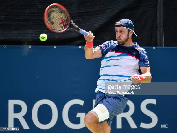 Paolo Lorenzi of Italy hits a return shot against Frances Tiafoe of the United States during day five of the Rogers Cup presented by National Bank at...