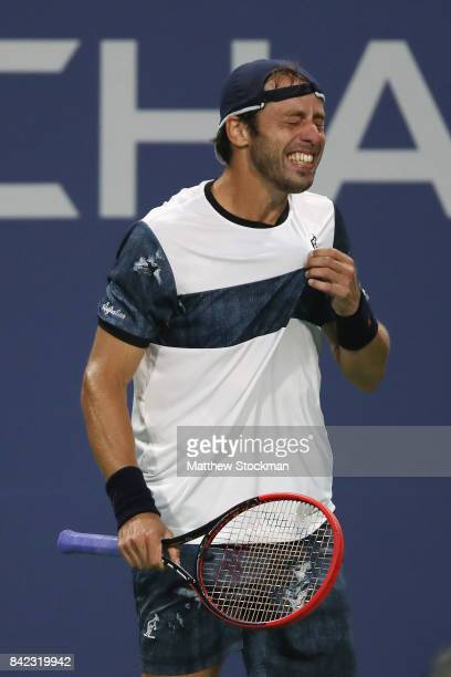 Paolo Lorenzi of Italy reacts during his men's singles fourth round match against Kevin Anderson of South Africa on Day Seven of the 2017 US Open at...