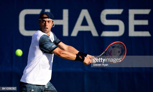 Paolo Lorenzi of Italy returns a shot against Gilles Muller of Luxembourg during their second round Men's Singles match on Day Three of the 2017 US...