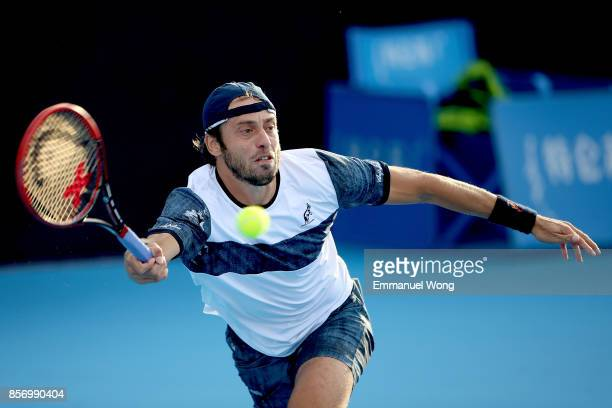 Paolo Lorenzi of Italy returns a shot against Leonardo Mayer of Argentina on day four of the 2017 China Open at the China National Tennis Centre on...