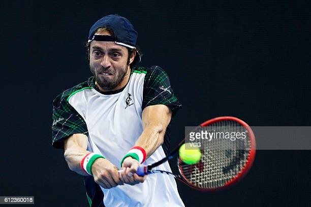 Paolo Lorenzi of Italy returns a shot against Rafael Nadal of Spain during the Men's singles first round match on day four of the 2016 China Open at...
