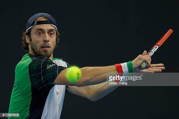 Paolo Lorenzi of Italy returns a shot against Rafael Nadal of Spain during the Men's singles second round match on day four of the 2016 China Open at...