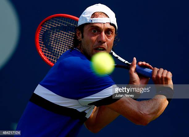 Paolo Lorenzi of Italy returns a shot against Yoshihito Nishioka of Japan during their men's singles first round match on Day Two of the 2014 US Open...