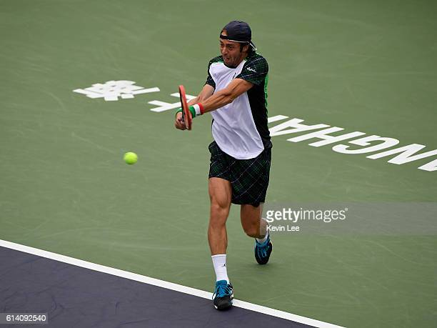 Paolo Lorenzi of Italy returns a shot to Milos Raonic of Canada in the men's singles second round match during Day 4 of the ATP Shanghai Rolex...
