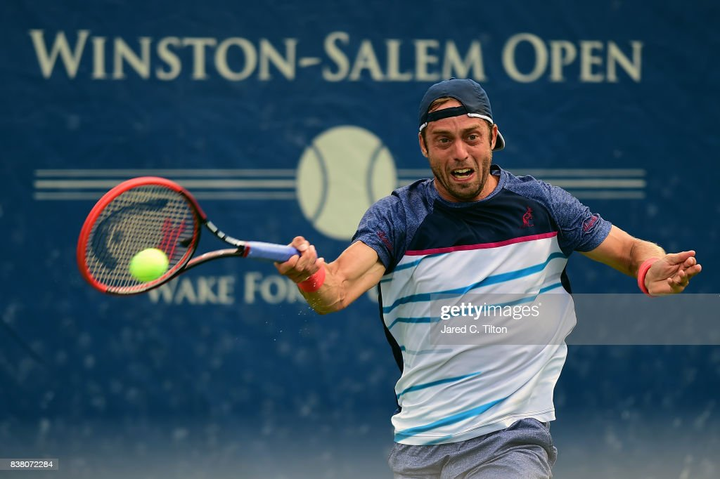Paolo Lorenzi of Italy returns a shot to Taylor Fritz during the fifth day of the Winston-Salem Open at Wake Forest University on August 23, 2017 in Winston-Salem, North Carolina.
