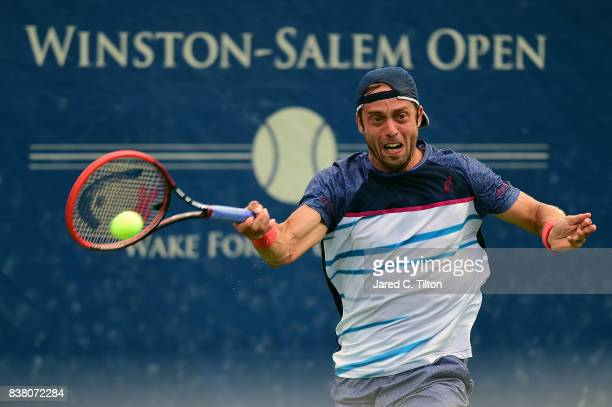 Paolo Lorenzi of Italy returns a shot to Taylor Fritz during the fifth day of the WinstonSalem Open at Wake Forest University on August 23 2017 in...