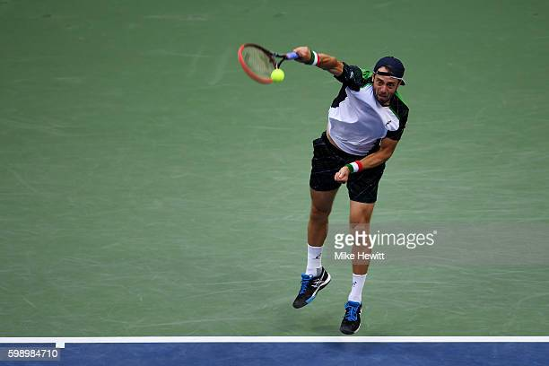 Paolo Lorenzi of Italy serves to Andy Murray of Great Britain during his third round Men's Singles match on Day Six of the 2016 US Open at the USTA...
