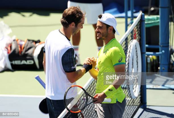 Paolo Lorenzi of Italy shakes hands with Thomas Fabbiano of Italy after winning his third round match on Day Five of the 2017 US Open at the USTA...