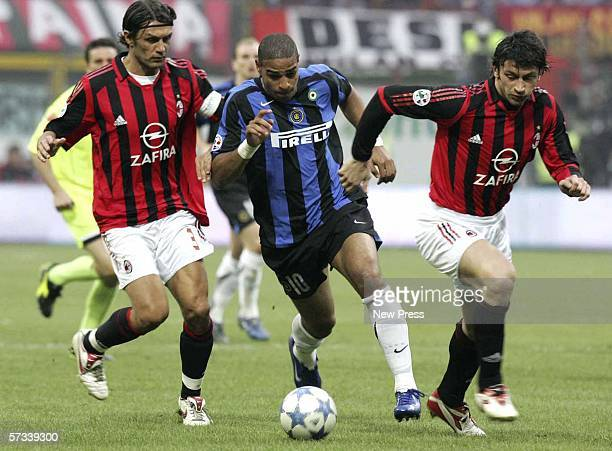 Paolo Maldini and Kakha Kaladze of AC Milan challenge Adriano of Inter during the Serie A match between AC Milan and Inter Milan at the San Siro on...