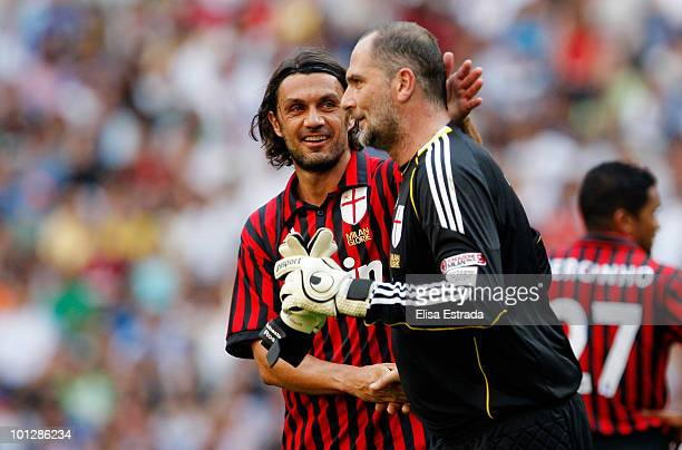 Paolo Maldini and Sebastiano Rossi of Milan in action during the Corazon Classic Match between Real Madrid and Milan on May 30 2010 in Madrid Spain