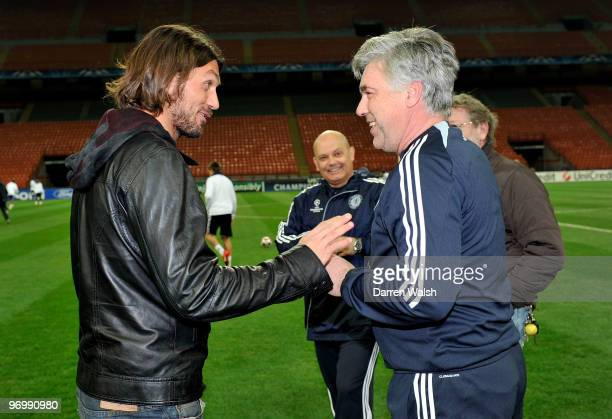 Paolo Maldini chats to Chelsea Manager Carlo Ancelotti during a training session on the day before the UEFA Champions League match between Inter...