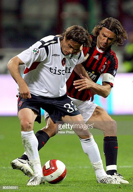 Paolo Maldini of AC Milan and Alessandro Matri of Cagliari in action during the Serie A match between Milan and Cagliari at the Stadio San Siro on...