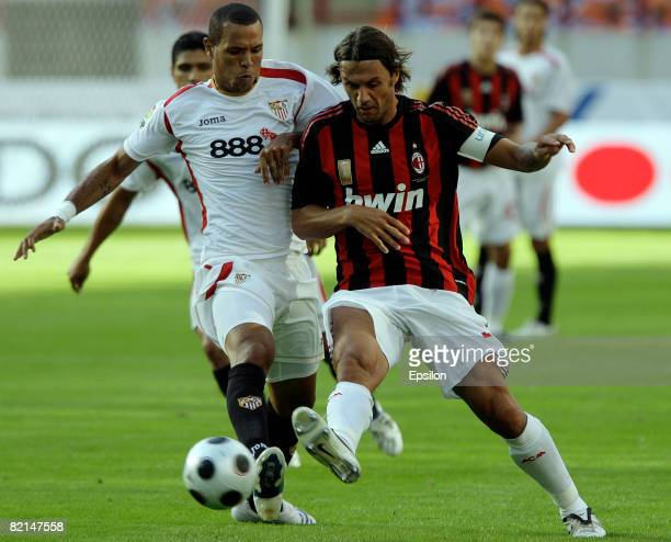Paolo Maldini of AC Milan competes for the ball with Luis Fabiano of Sevilla during the Russian Railways Cup at the Lokomotiv Stadium on August 01...