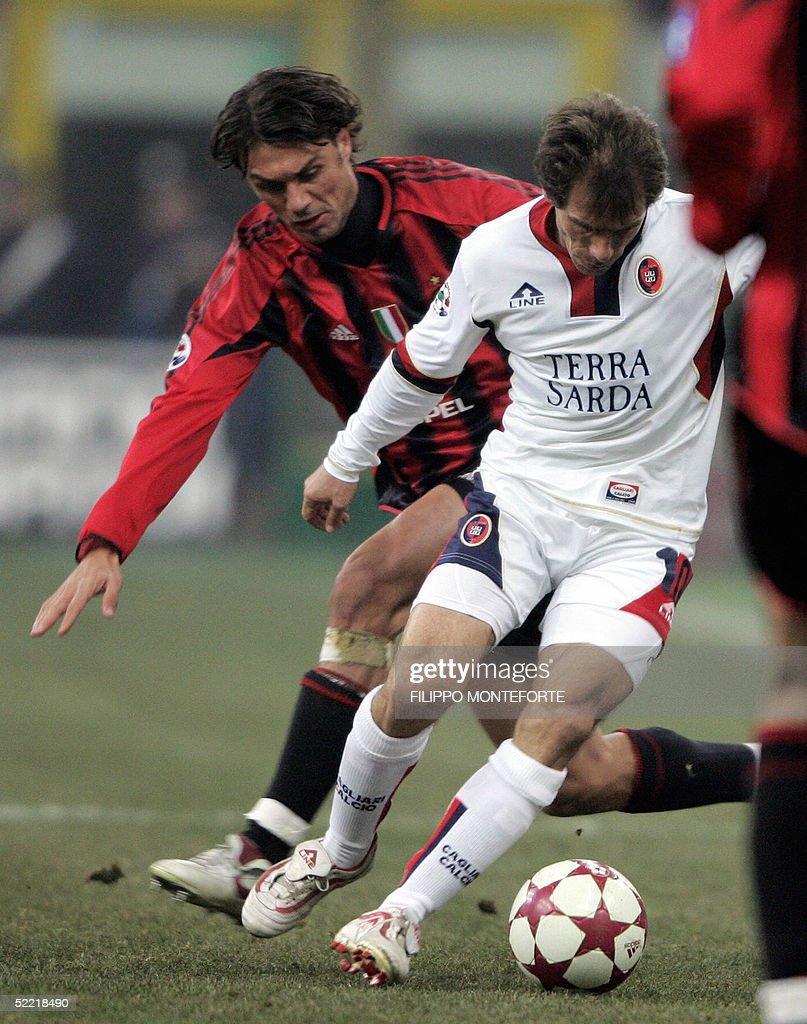 Paolo Maldini L of Ac Milan tackles Gi