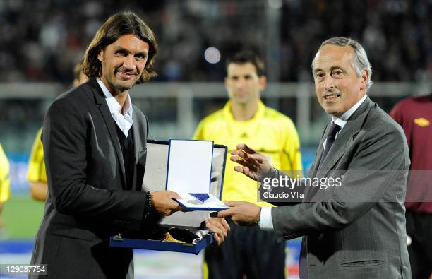 Paolo Maldini receives a commemorative award from Giancarlo Abete for the achievement of reaching 100 international caps for his country ahead of the...