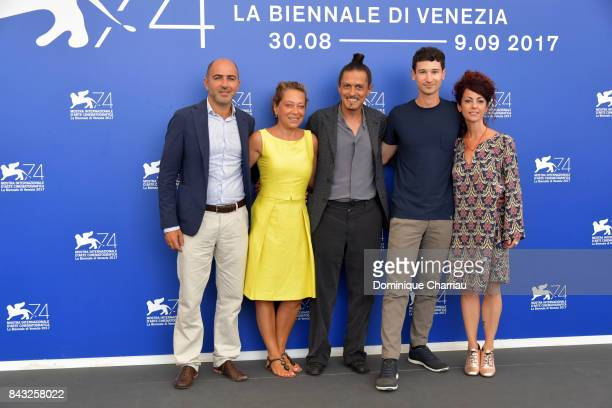 Paolo Manera Paola Malanga Simone Catania Giovanni Totaro and guest attend the 'Happy Winter' photocall during the 74th Venice Film Festival on...