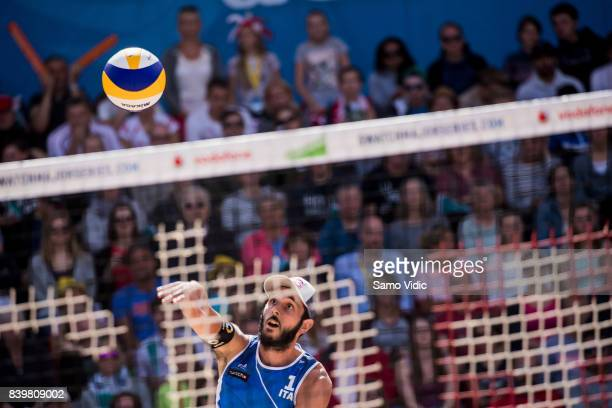 Paolo Nicolai of Italy serves the ball during the bronze medal match against Piotr Kantor and Bartosz Losiak of Poland at the Swatch Beach Volleyball...