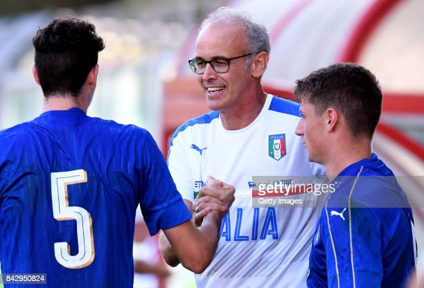Paolo Nicolato head coach of Italy U19 shankes hands with Alessandro Bastoni of Italy U19 during the match between Italy U19 and Russia U19 at Stadio...