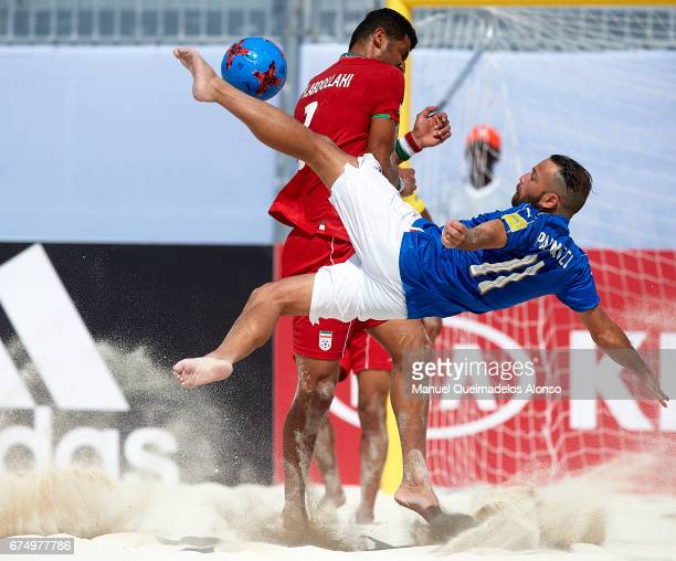 Paolo Palmacci of Italy attempts a scissor kick shot on goal in front Hassan Abdollahi of Iran during the FIFA Beach Soccer World Cup Bahamas 2017...