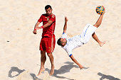 Paolo Palmacci of Italy makes a spectacular attempt on goal as Jose Antonio Mayor of Spain tries to block during the Men's Beach Soccer Group B match...
