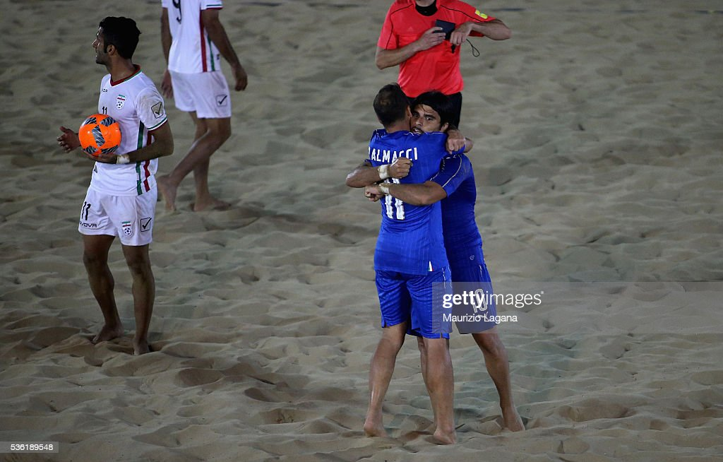 Paolo Palmaci (L) and Gabriele Gori of Italy celebrates during the beach soccer international frienldy between Italy and Iran on May 31, 2016 in Catania, Italy.
