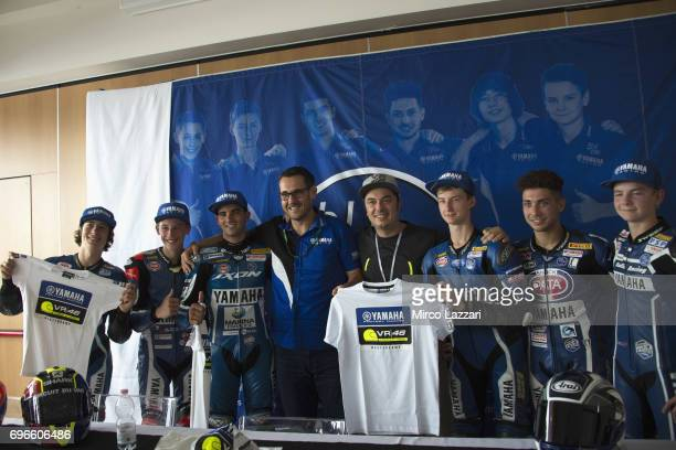 Paolo Pavesio of Italy and Yamaha Motor Europe NV and Alessio Salucci of Italy and VR46 Riders Academy and the young riders pose during the Yamaha R3...