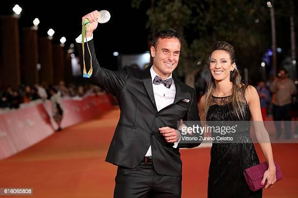 Paolo Pizzo and Lavinia Bonessio walk a red carpet for '7 Minuti' during the 11th Rome Film Festival at Auditorium Parco Della Musica on October 21...