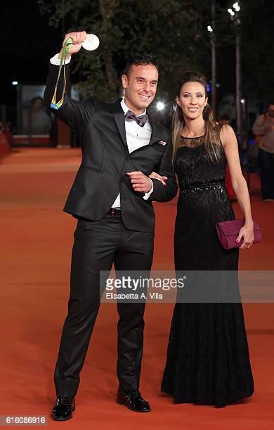 Paolo Pizzo and wife Lavinia Bonessio walk a red carpet for '7 Minuti' during the 11th Rome Film Festival at Auditorium Parco Della Musica on October...